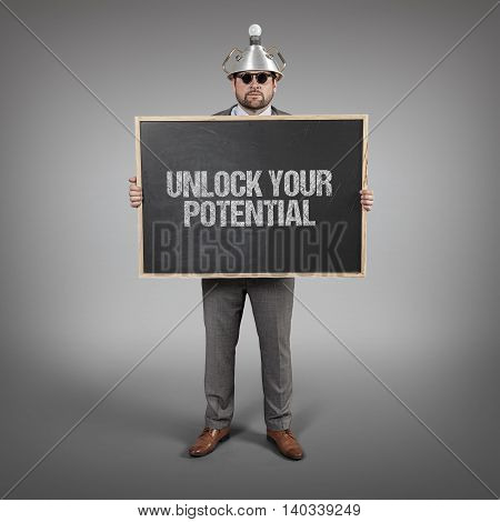 Unlock your potential text on blackboard with science businessman holding blackboard sign