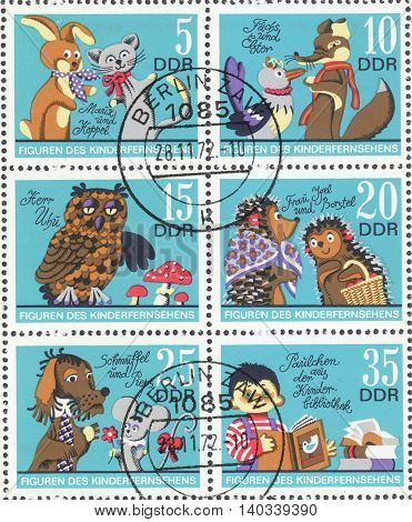 MOSCOW RUSSIA - CIRCA FEBRUARY 2016: a post stamp printed in DDR shows scenes from the cartoons the series