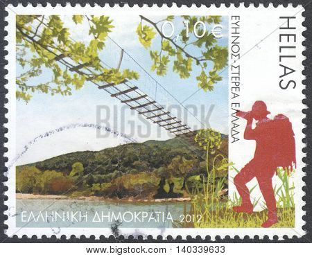 MOSCOW RUSSIA - CIRCA APRIL 2016: a post stamp printed in GREECE shows the Evinos river Central Greece the series