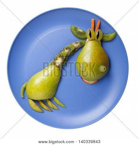 Giraffe made of fruits on blue plate