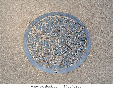 NARA, JAPAN - JUNE 06, 2016: The deer was engraved on manhole cover of Nara City in Nara, Japan.