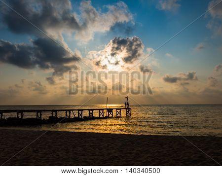 Wooded bridge to the sea between sunset at Koh Kood Trat Thailand