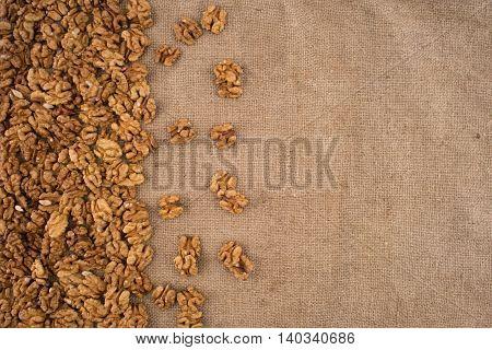 Walnut kernels walnuts on burlap. Top view.
