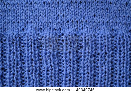 Background with knitting patterns on clothing blue