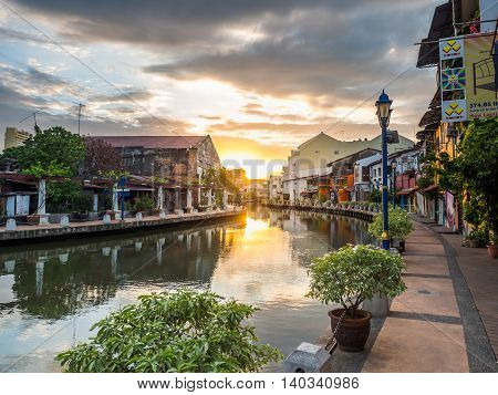MALACCA MALAYSIA - February 29: Early morning with sunrise along the riverside on February 29 2016 in MALACCA Malaysia. It is the old building with footpath on riverside.