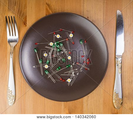 Abstract idea of technology as food, leds on the plate