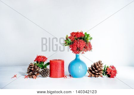 Red Ixora Flower In Blue Ceramic Vase And Red  Candle