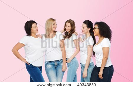friendship, diverse, body positive and people concept - group of happy different size women in white t-shirts hugging over pink background