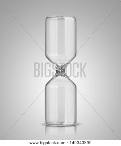 Empty hourglass on a glossy gray background