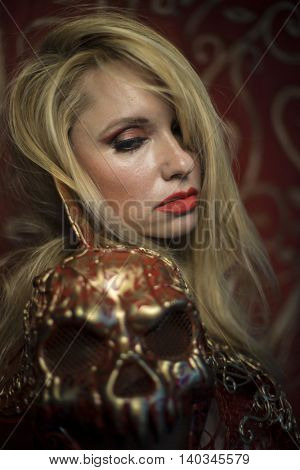 Skull. blonde dressed in red armor gold on red art nouveau flourishes