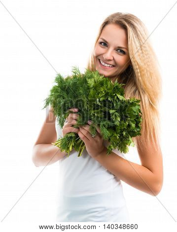 Portrait of a beautiful happy young woman with a bouquet of fresh greenery - parsley and dill