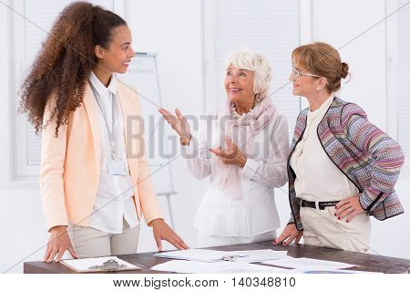 Shot of a group of beautiful female employees smiling together in an office