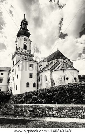 Ancient castle in Nitra Slovak republic. Cultural heritage. Black and white photo. Architectural theme. Place for worship. Vertical composition.