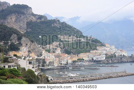 Beautiful landscape with sea, rocks and traditional Italian architecture at sunset. Amalfi Coast, Italy.