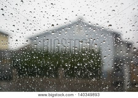 Rain shows its mark on windowpane - closeup