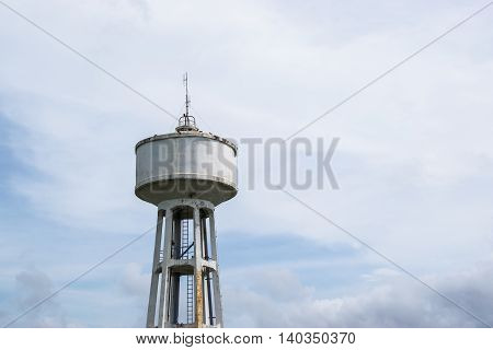 Water Tank Tower with cloud storm, abandon water tank Tower