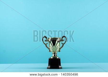 Award Winning Trophy In Blue Background