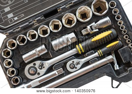 Closeup tool box kit set of wrenches and bits with layout isolated on white background
