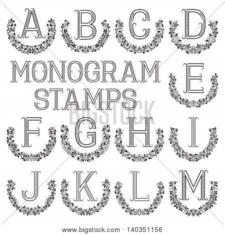 Monogram stamps set. Letters from A to M in semicircular floral frames.