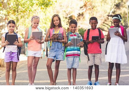 Group of school kids using digital tablet at school campus