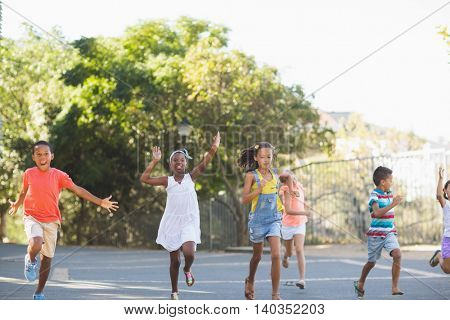 Happy school kids running in school campus