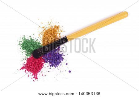 make-up brush on pink crushed eyeshadow,  isolated on a white background