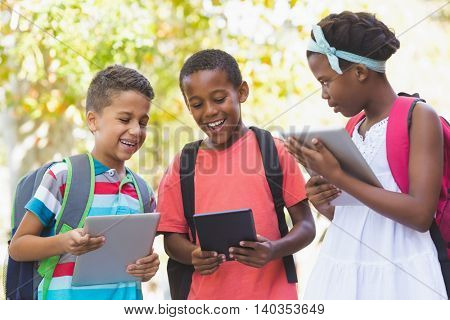 School kids using digital tablet at school campus