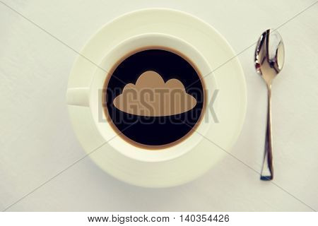 drinks and modem technology concept - cup of black coffee with cloud silhouette on surface, spoon and saucer on table