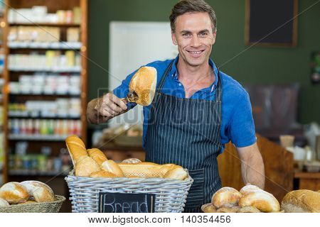 Portrait of male staff working at bakery store in supermarket