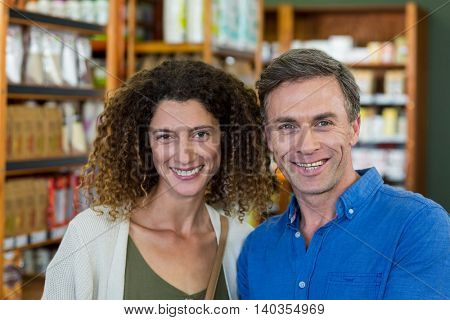 Portrait of smiling couple in supermarket