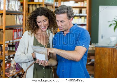 Couple shopping together for groceries in supermarket
