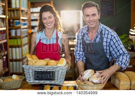 Portrait of staff working at bakery counter in supermarket