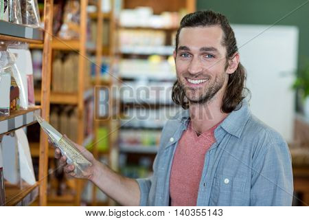 Portrait of man shopping for groceries in supermarket