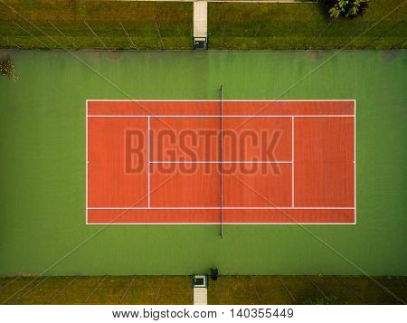 Outdoors tennis court seen from the air directly above