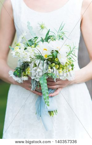 Very beautiful  bride's bouquet in the hands
