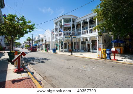KEY WEST FLORIDA USA - MAY 02 2016: Typical Florida houses in Duval street in the center of Key West