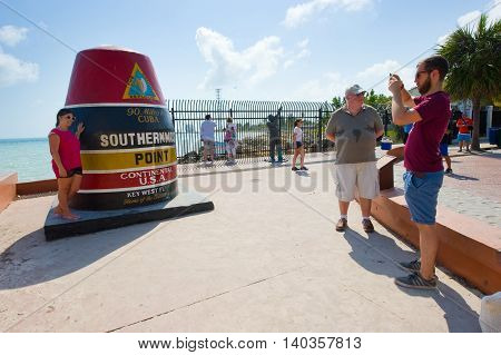 KEY WEST FLORIDA USA - MAY 02 2016: Tourists are making pictures at the southernmost point of the USA in Key West in Florida