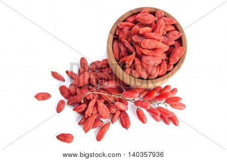 berberries near goji berries heap and bowl with goji isolated on white background.top view
