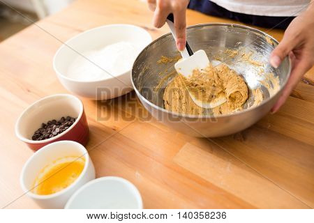 Mixing paste in bowl for making cookies