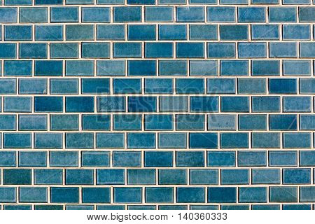 Pattern of shiny blue brick wall background.