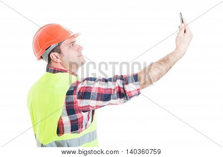 Attractive Constructor Taking A Selfie With Smartphone