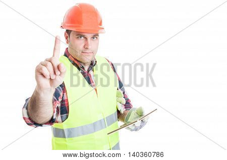 Male Constructor With Tablet Doing A Waiting Gesture