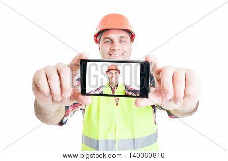 Cheerful Builder Using Phone To Take Photograph