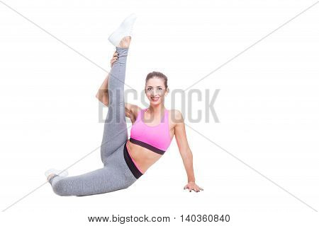 Fit Girl Sitting Like Ballerina With Leg Up