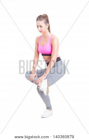 Fit Woman Stretching One Leg Before Training