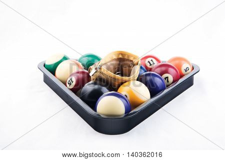 Golden wallet inside colorful billiards's balls on white