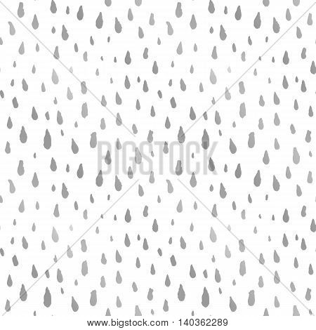 Cute decorative seamless pattern with raindrops. Hand drawn ink different sizes silver drops with rough edges on white background. Endless backdrop for cloth, wallpaper or wrapping