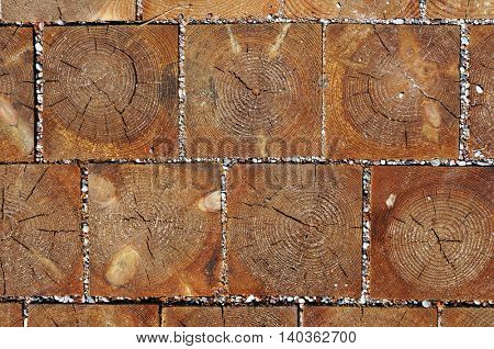 Wooden blocks pavement texture. Abstract natural wood background.