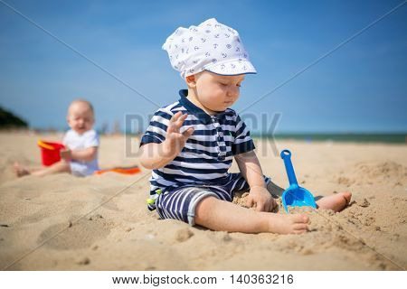 Baby boy playing at the beach of Baltic Sea, Poland