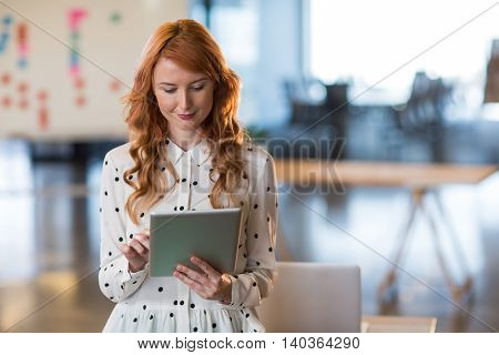 Woman using digital tablet in creative office